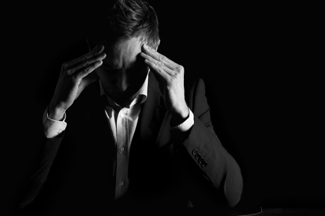 depressed overworked stressed tired businessman suit pastor black and white  courtesy of shutterstock com Lichtmeister_72661231[1]